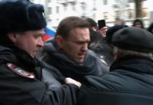 Navalny dragged away by police
