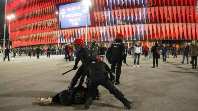 Police officer dies after violent clashes before game